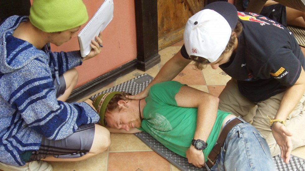 Instructor Zach plays a victim during the students' WFR training